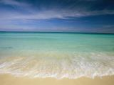 Clear Blue Water And Wispy Clouds Along The Beach at Cancun by Collection